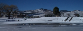 Snow in Ashley Pond and Pajarito Mountain
